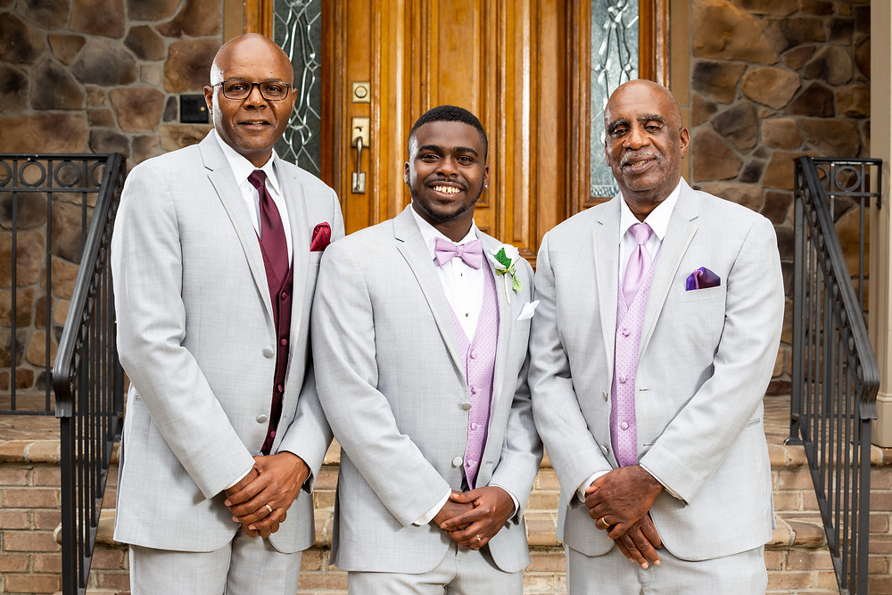 John posing with his father-in-law and father after the wedding in Fairfax, Virginia.