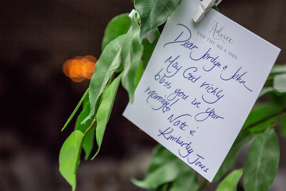 A note from a guest left on the signature tree before the wedding reception in Fairfax, Virginia.