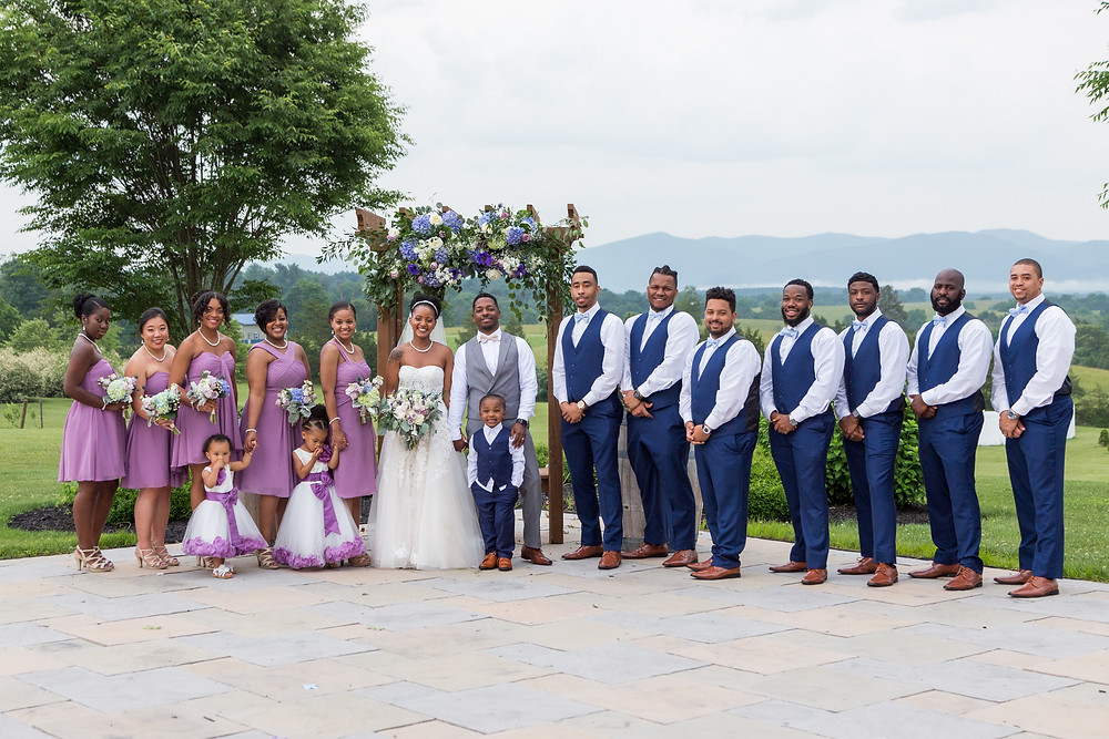 The Chander wedding party posing for a formal portrait at Crosskeys Vineyards in Mt. Crawford, Virginia.