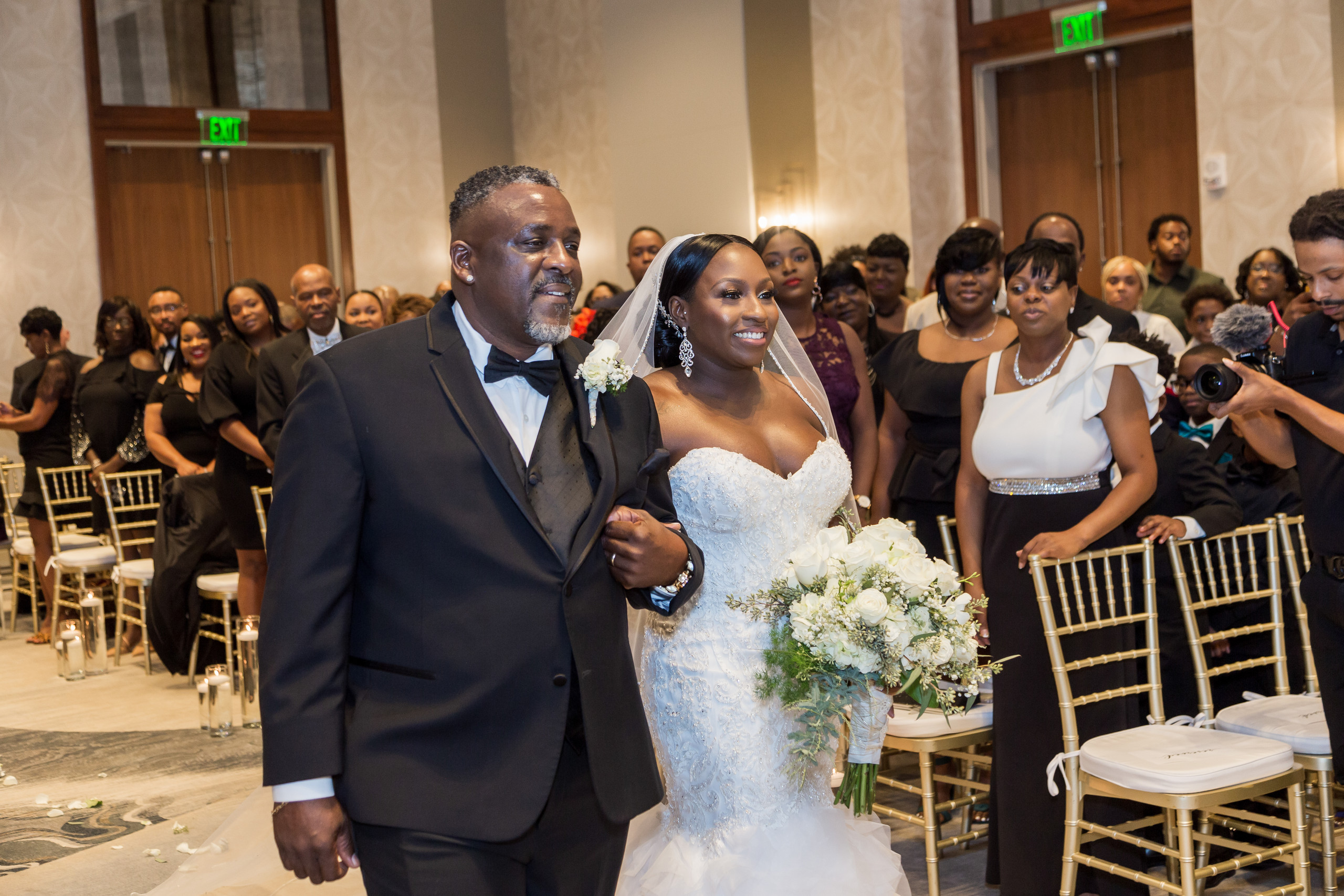 The bride and her father walking down the isle during the wedding ceremony at the Hilton Main in Norfolk, Virginia.