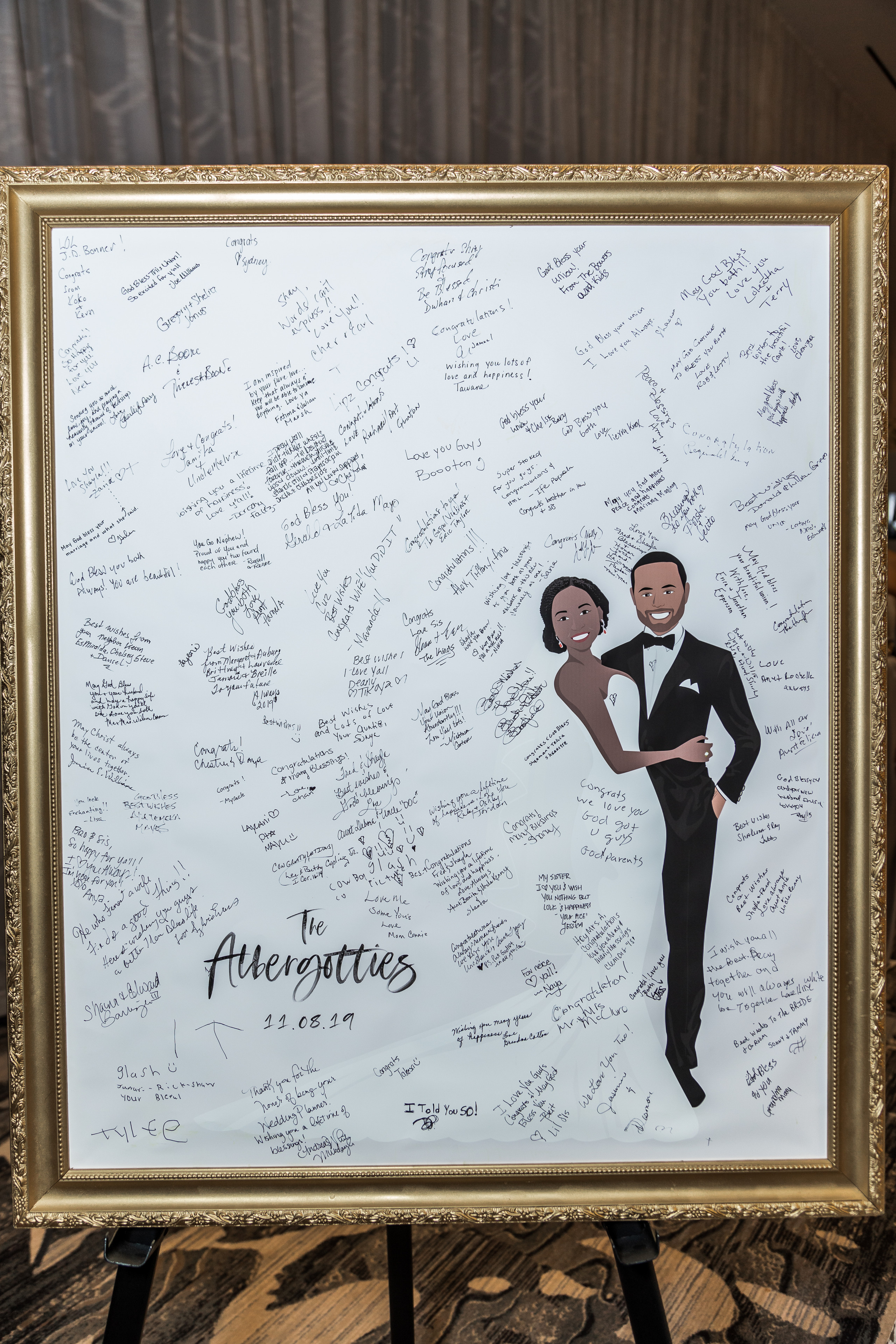 The bride and groom's custom cartoon guest signing board during the wedding reception at the Hilton Main in Norfolk, Virginia.