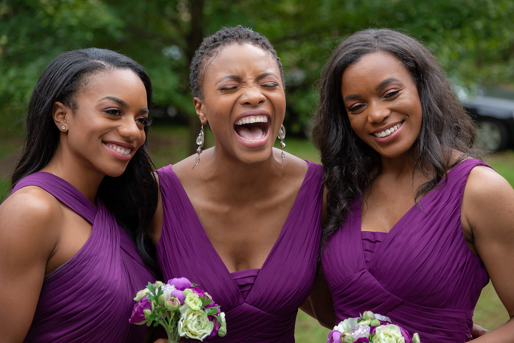 The bridesmaids share a moment while the couple takes formal portraits after the wedding in Fairfax, Virginia.