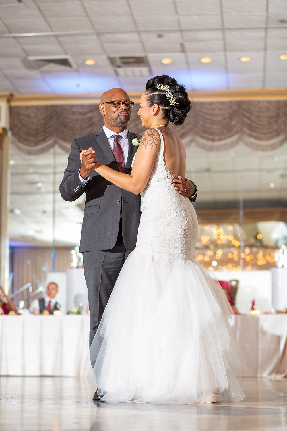 Bride and Father-of-the-Bride dance during the wedding reception at Martin's Crosswinds in Greenbelt, Maryland.