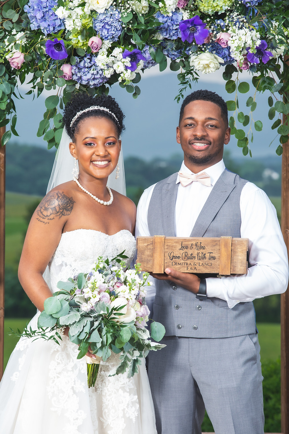 The bride and groom pose for a formal portrait with the bouquet from The Faded Poppy and the Crosskeys Love Letter box after the wedding ceremony at Crosskeys Vineyards in Mt. Crawford, Virginia.