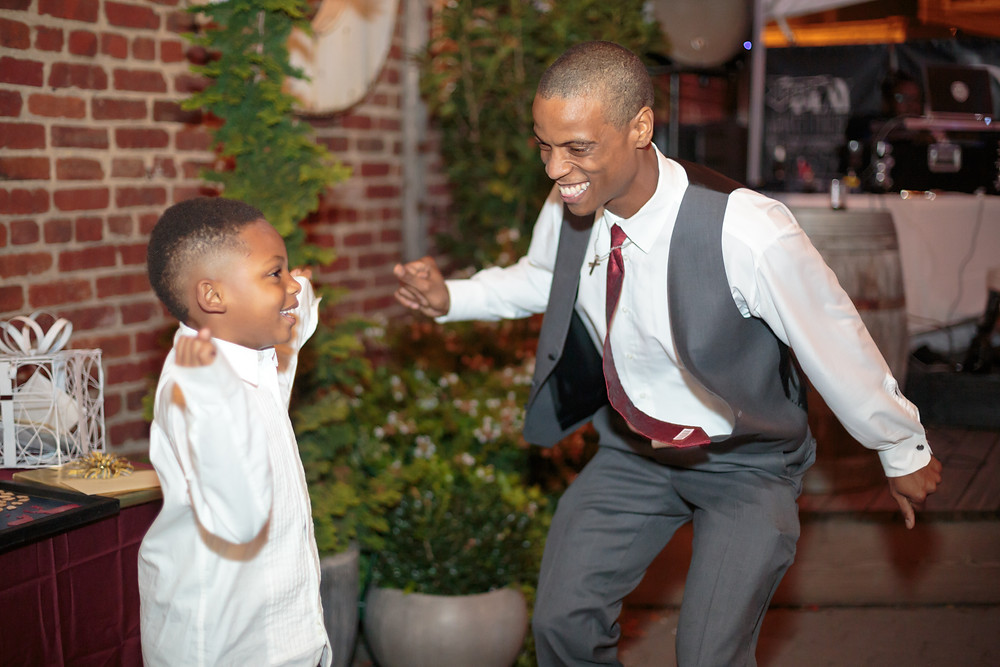 The groom dancing with his nephew during the wedding reception at the Gallery O on H in Washington DC.