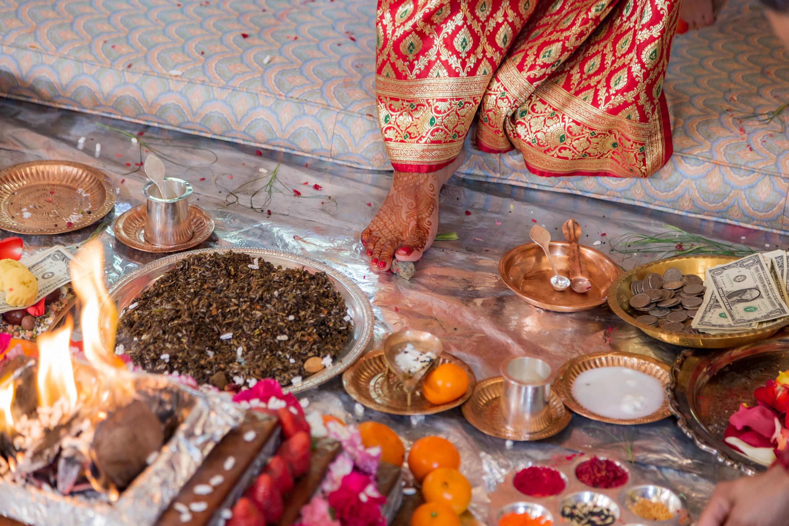 The bride performing a ritual during the Hindu Ceremony at the ISKCON of DC in Potomac, Maryland.