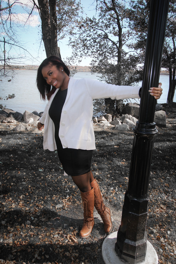 Aja poses for a photo during her portrait session at Founders Park in Alexandria, VA.