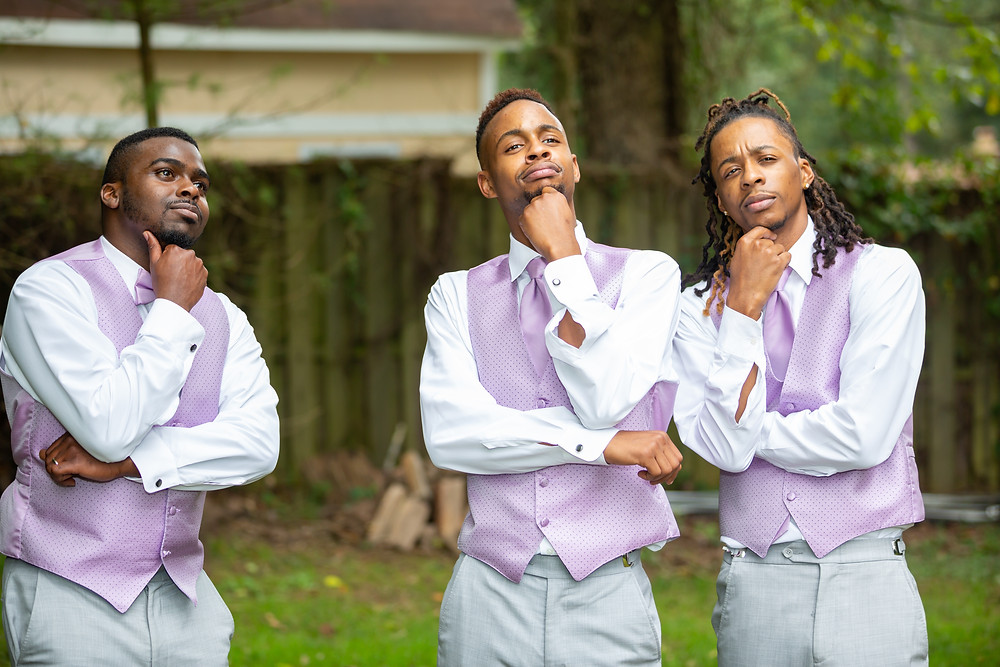 The groom and groomsmen pose for a silly photo during the wedding reception in Fairfax, Virginia.
