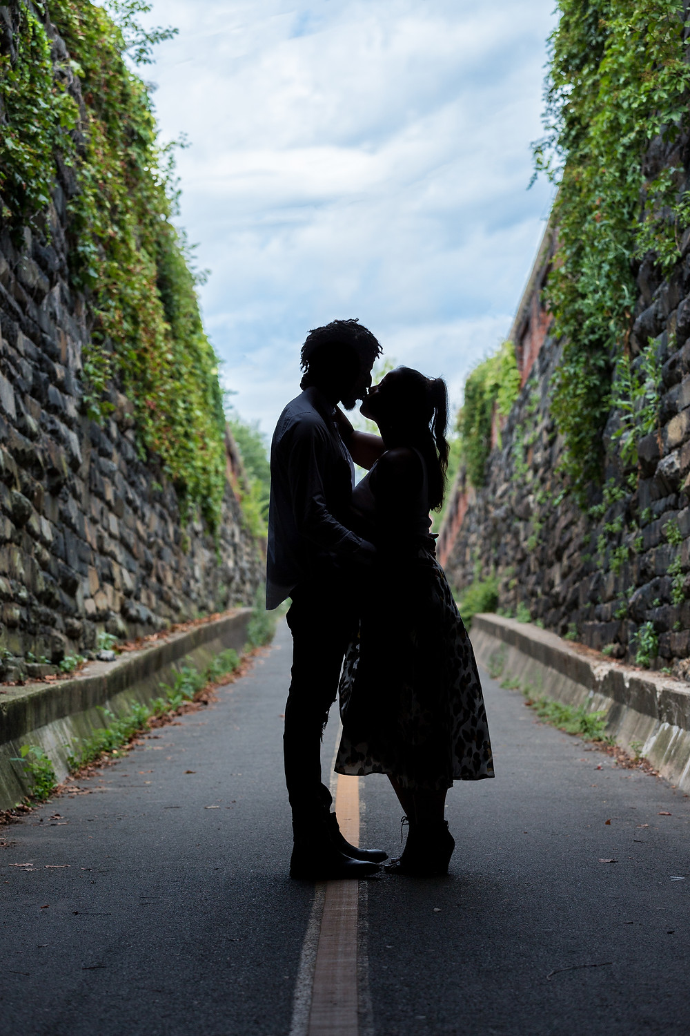 Couple kissing in the Wilkes Tunnel during their engagement session in Old Town Alexandria, Virginia.