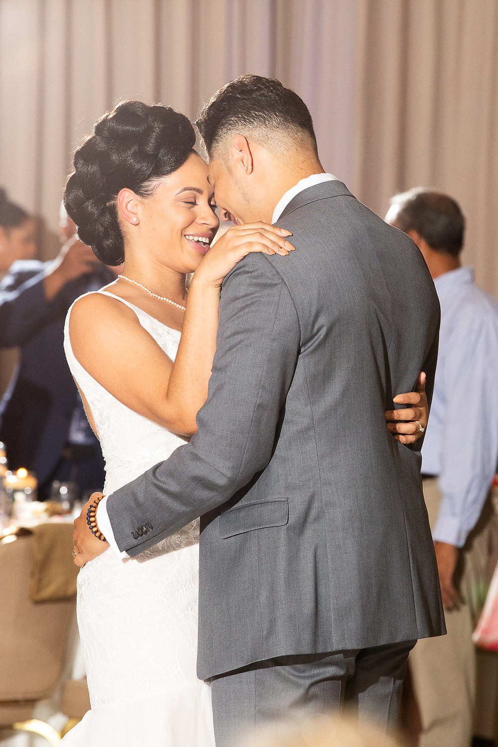 Bride and goom share a smile during their first dance at Martin's Crosswinds in Greenbelt, Maryland.