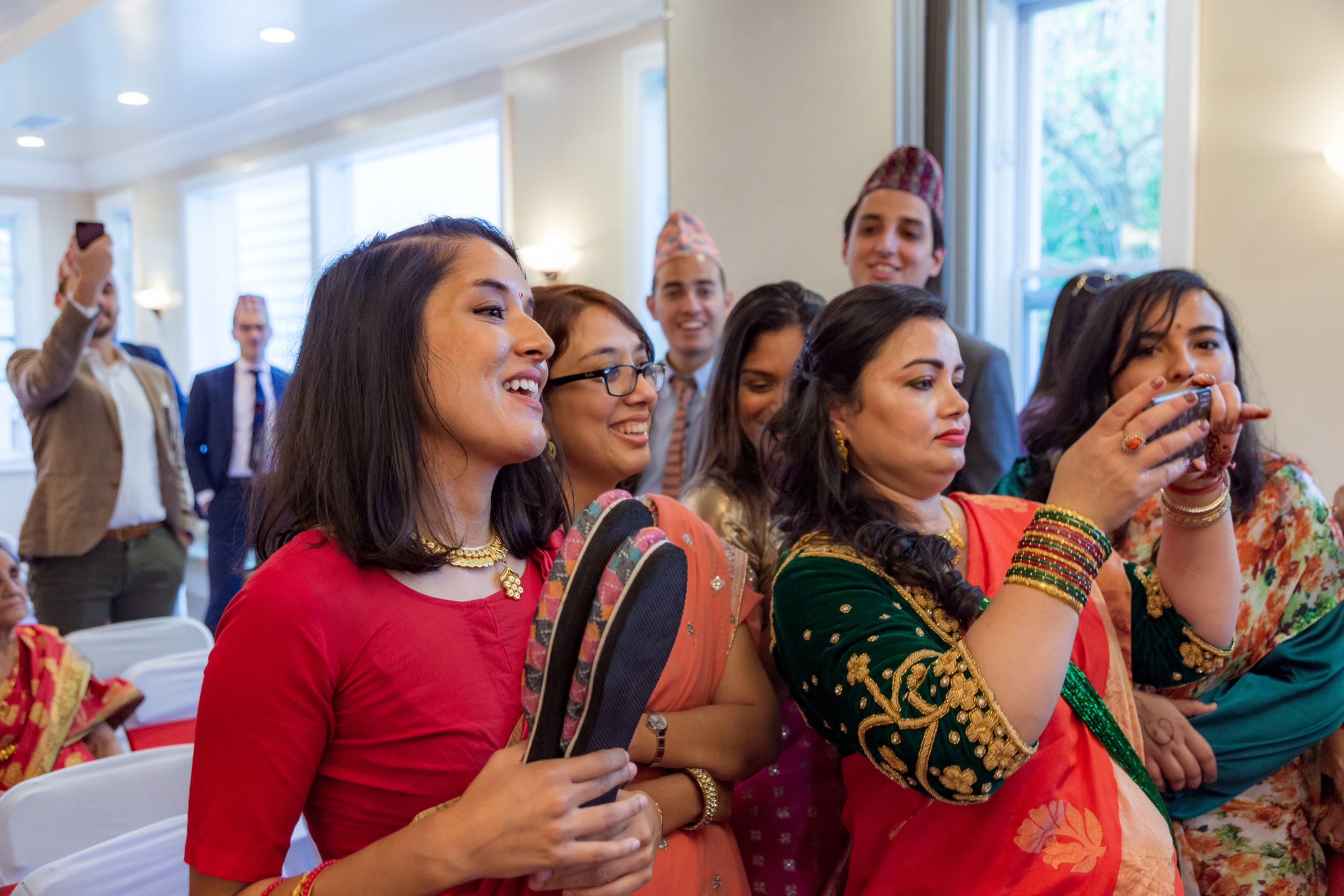 The bride's sisters steal the groom's shoes at some point during the Hindu ceremony and the groom must buy them back as an offering to the bride's family during the Hindu Ceremony at the ISKCON of DC in Potomac, Maryland.