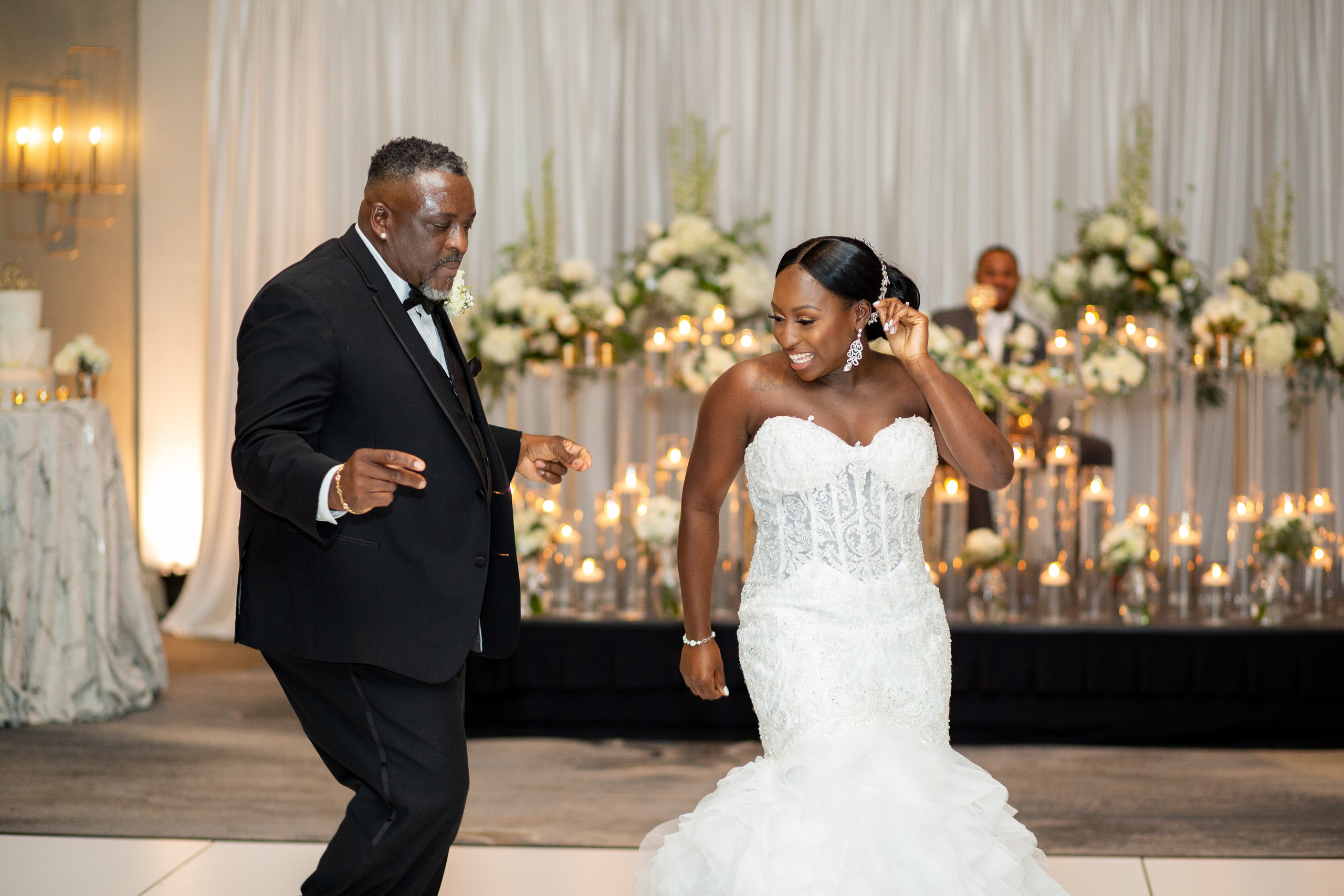 The father of the bride and bride have fun with their dance during the wedding reception at the Hilton Main in Norfolk, Virginia.