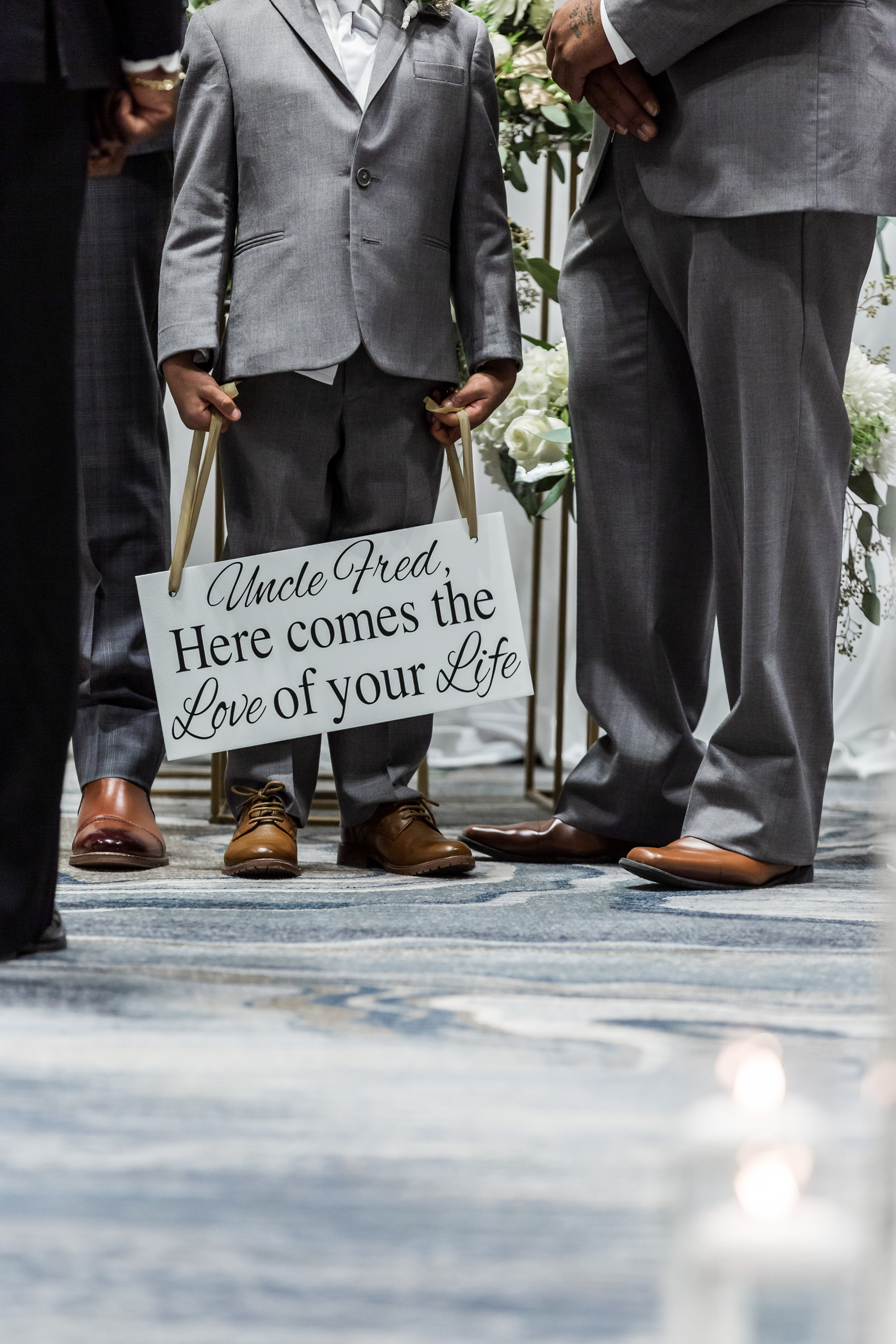 The ring bearer standing with the groom at the alter during the wedding ceremony at the Hilton Main in Norfolk, Virginia.