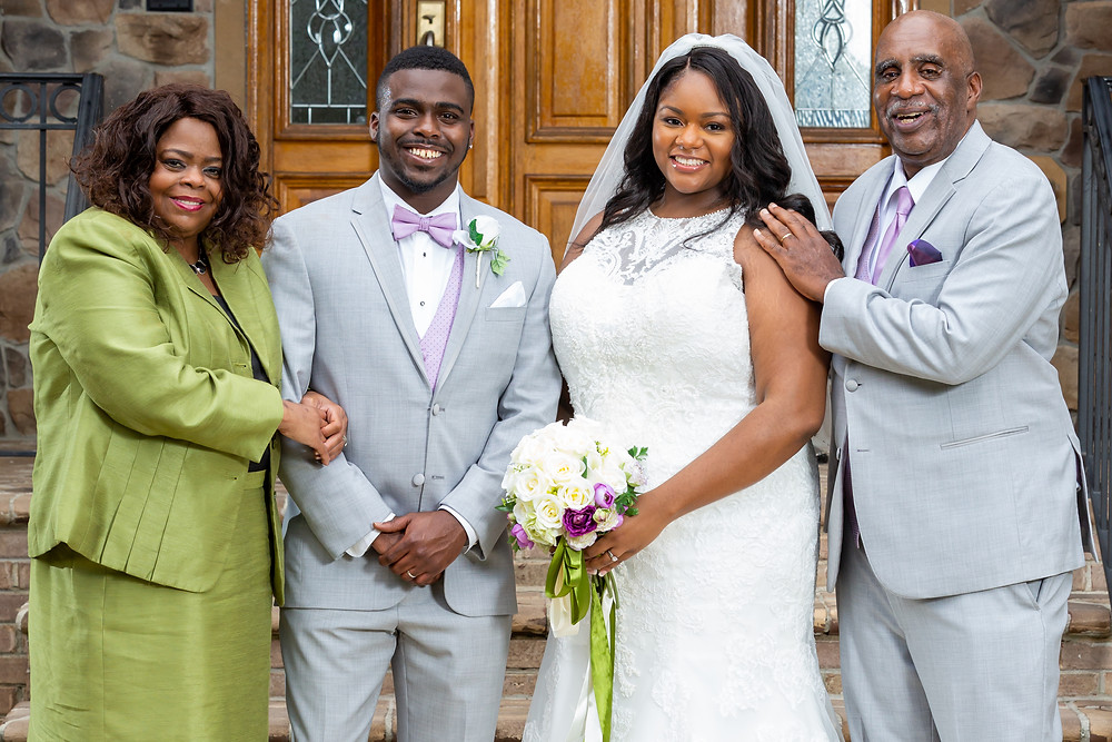 Jordyn and John pose with the parents of the groom for a wedding portrait after the ceremony in Fairfax, Virginia.