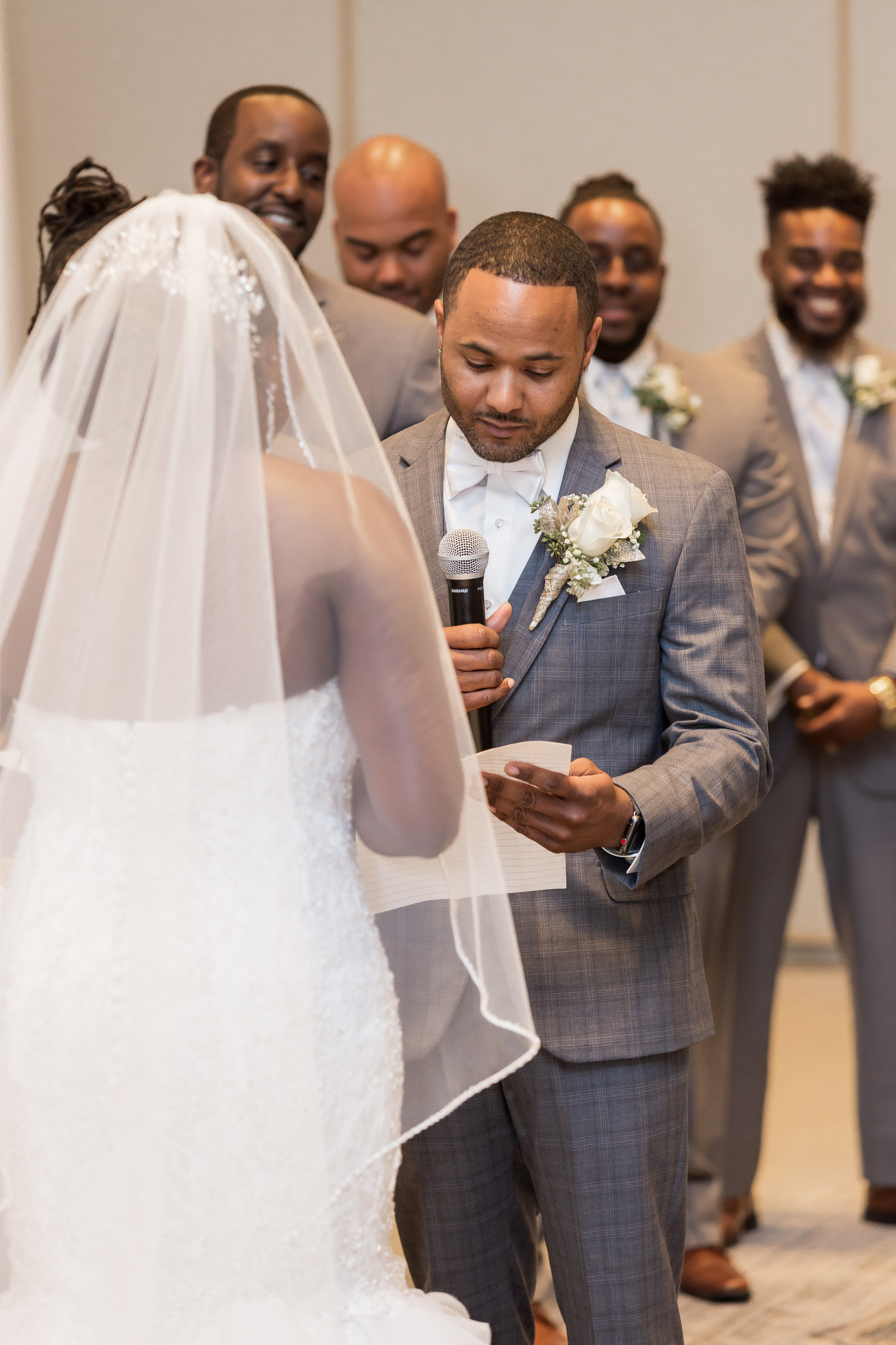 The groom reciting his hand-written vows to his bride during the wedding ceremony at the Hilton Main in Norfolk, Virginia.