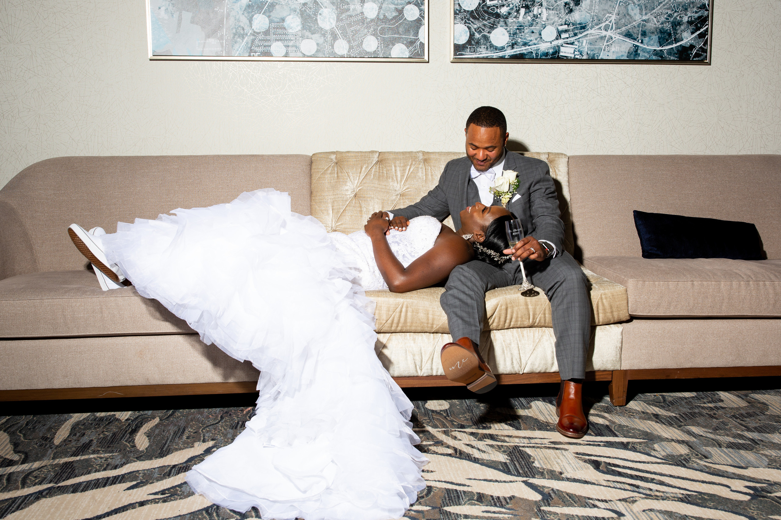 The bride and groom pose for a portrait during the wedding reception at the Hilton Main in Norfolk, Virginia.