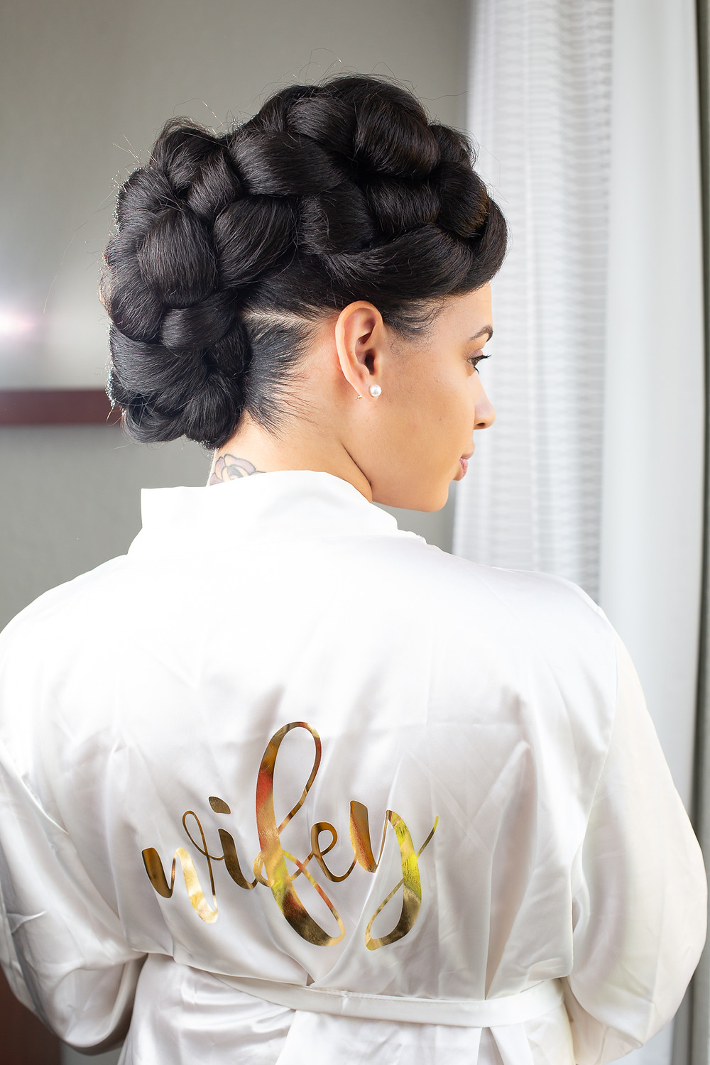 Bride showing off wedding day hair in her bridal robe before the wedding ceremony at Martin's Crosswinds in Greenbelt, Maryland