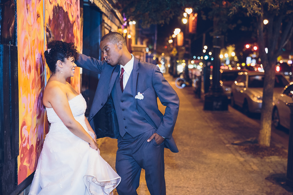 The bride and groom step out onto H street in Washington DC for some evening portraits.