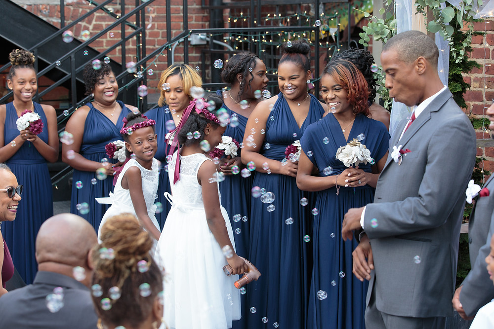 The flower girls entering the Sellers wedding at the Gallery O on H in Washington DC.