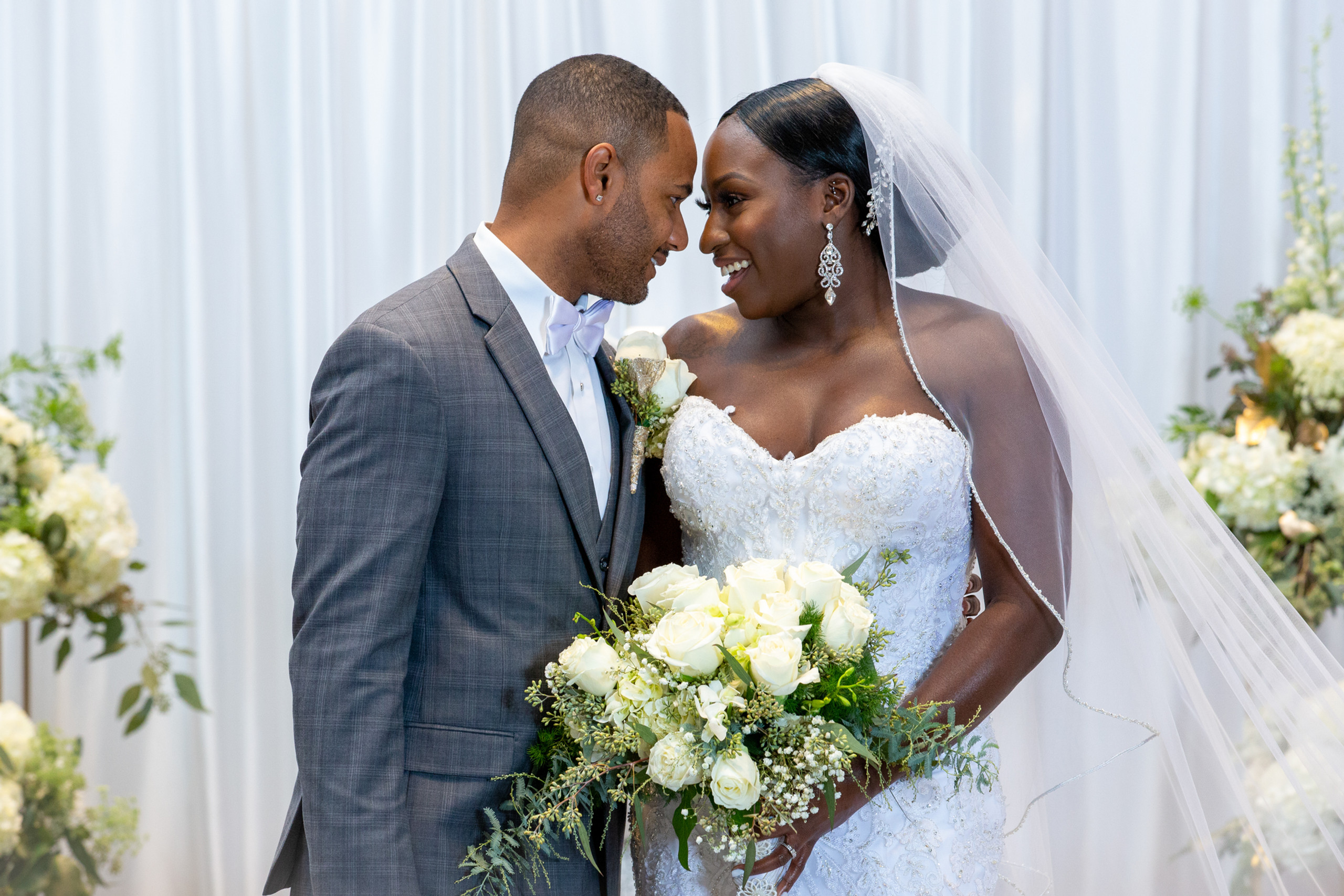 The bride and groom pose for a portrait after the wedding ceremony at the Hilton Main in Norfolk, Virginia.