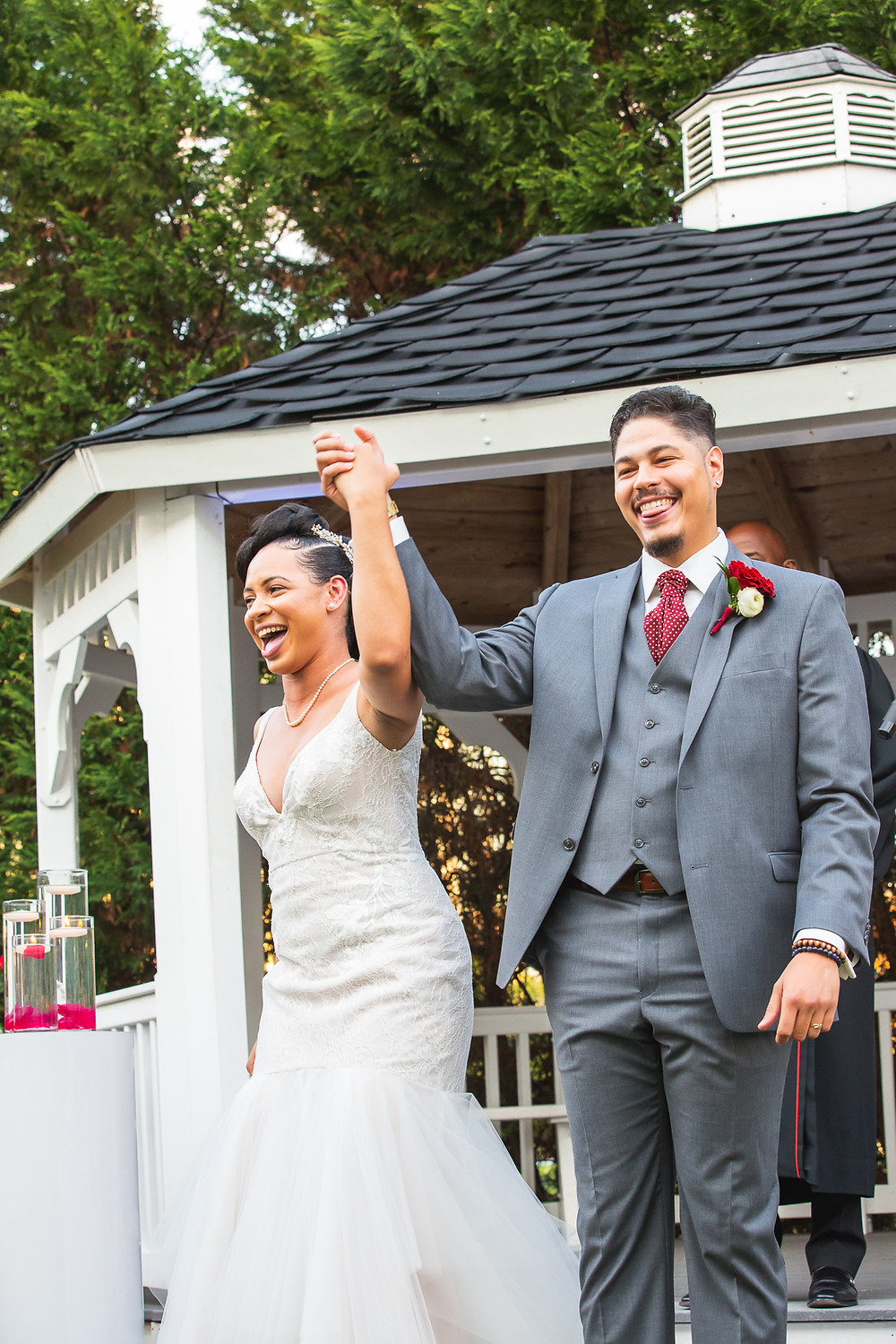 Bride and Groom after jumping the broom during the wedding ceremony at Martin's Crosswinds in Greenbelt, Maryland.