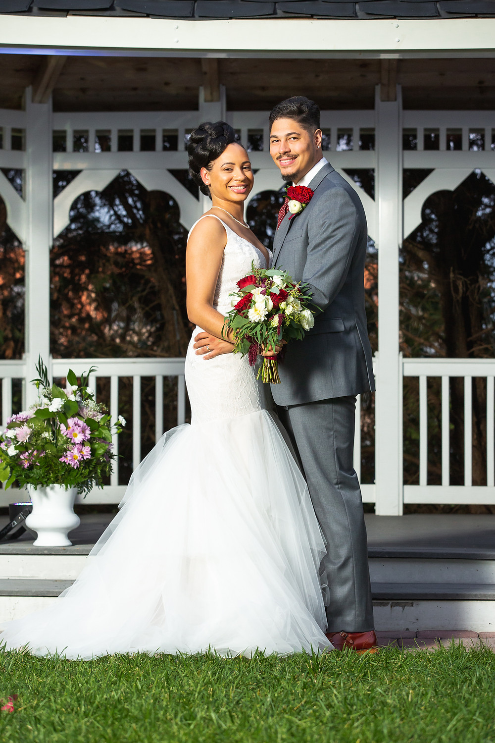 Bride and groom taking a classic wedding portrait after the wedding ceremony at Martin's Crosswinds in Greenbelt, Maryland.