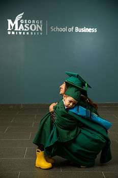 Mother and her son in cap and gown during a graduation portrait session at George Mason University in Arlington, Virginia.