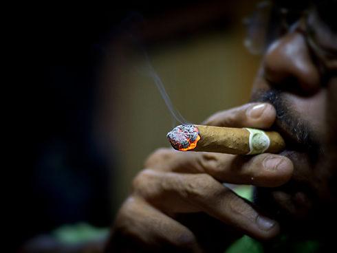 Close up view smoking of a cigar.jpg