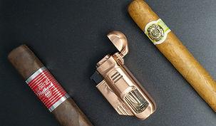 2 cigars with lighter.jpg
