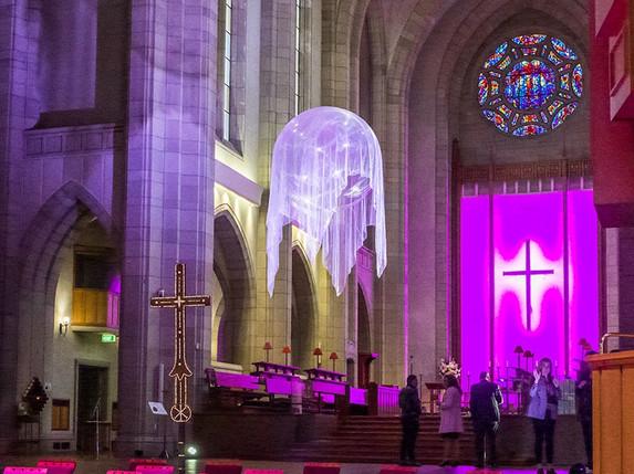 Awakenings IV, 2020 installation custom pvc sphere, helium, organza mesh, light, Holy Trinity Cathedral Parnell, Artweek Auckland 2020 Photo courtesy of Artsdiary http://artsdiary.co.nz/146/3413.html