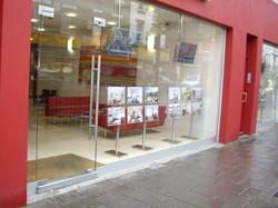 Frameless glass shop front London
