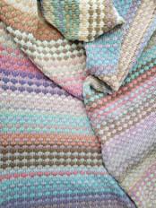 Machine knit blanket in tuck stitch