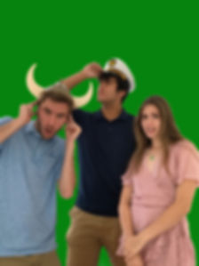Three friends posing in front of the green screen with prop hats.