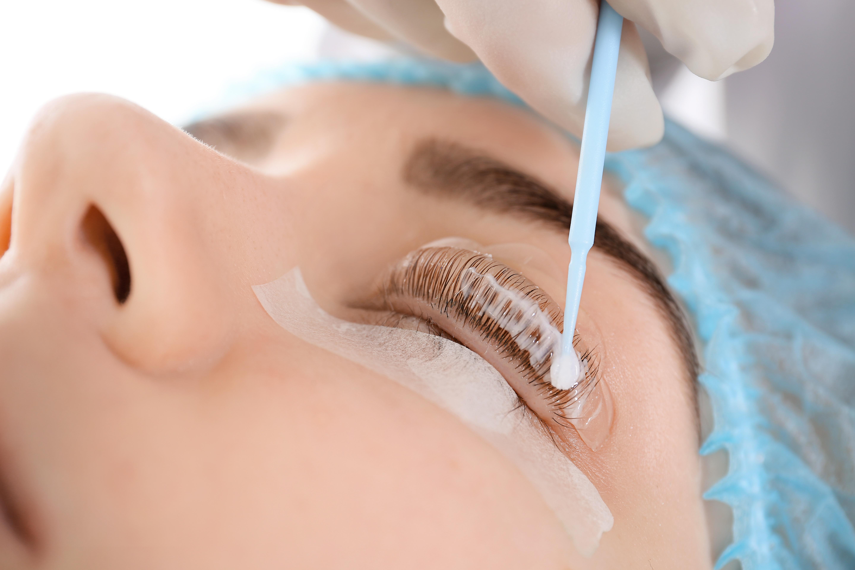 Young woman undergoing procedure of eyel