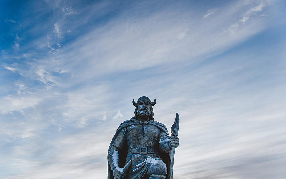 Viking statue against a blue sky
