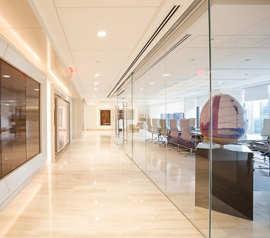 Office building hallway with glass walls
