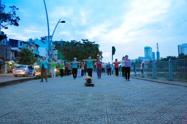 Early morning exercise on Truong Sa street, Tan Dinh district, Saigon