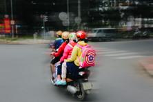 Family on scooter, District 1, Saigon