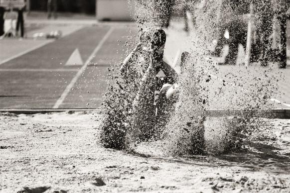 Long jumper lands in sand.jpg