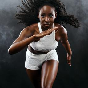 Strong athletic black skin woman sprinte