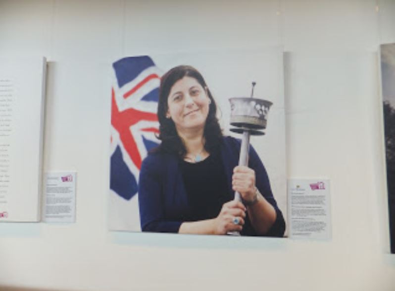 Georgia Vossou holding an Olympic torch