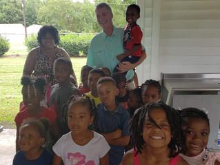 PASA students meet Congressman Tom Rice at Mullins Rec Back To School supplies Giveaway.