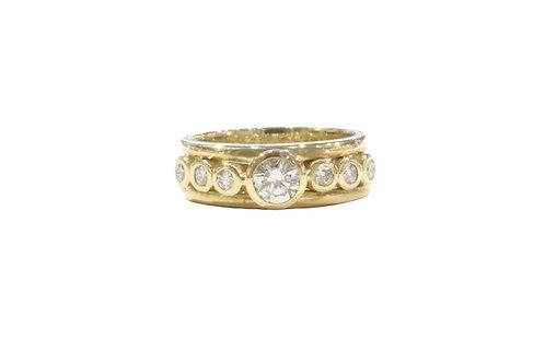 Seven stone diamond ring set on a triple band