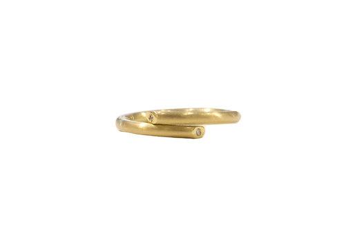 Diamond set twist ring