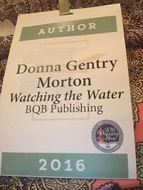 Author badge at SIBA. BQB Publishing. Watching the Water.