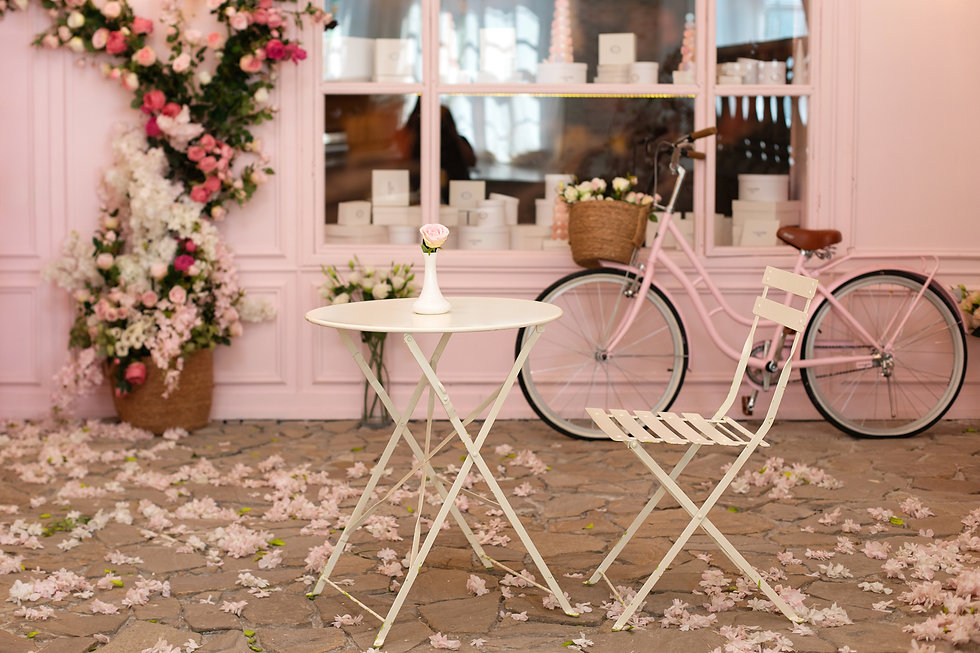Empty cafe terrace with white table and