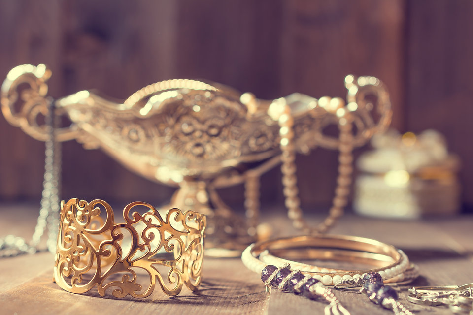 Vintage golden bracelet and silver vase