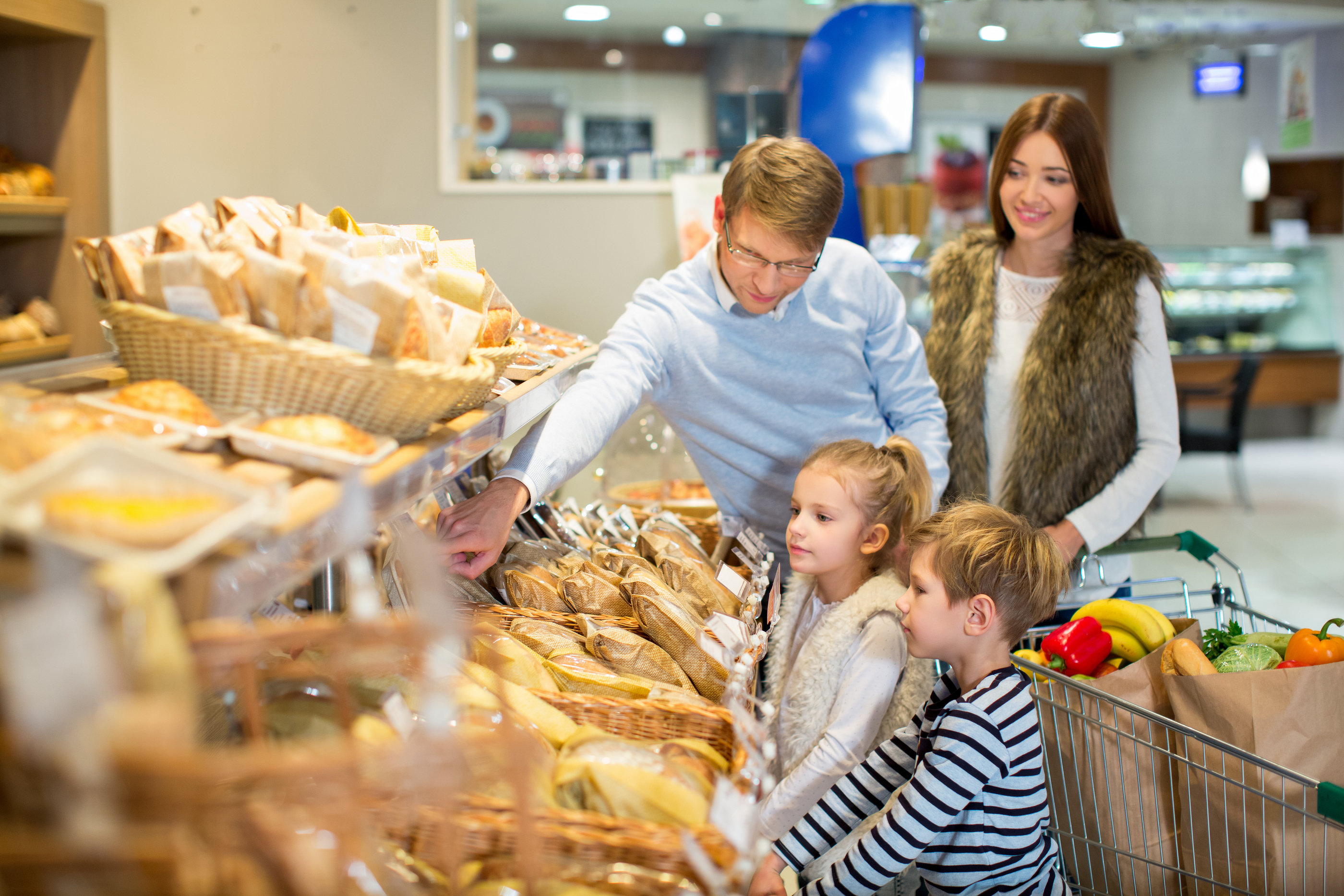 Smiling family in bakery