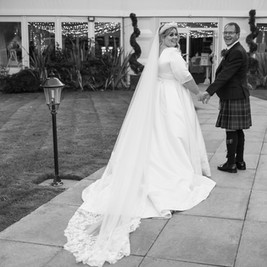 Bespoke Structured Satin Bridal Gown. Pleated skirt with embellished embroidery detail and matching bespoke veil.