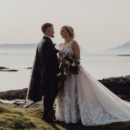 Bespoke Wedding Dress - Starry embroidery with soft dreamy tulle and twinkly glitter layered skirt on a cliff-top.